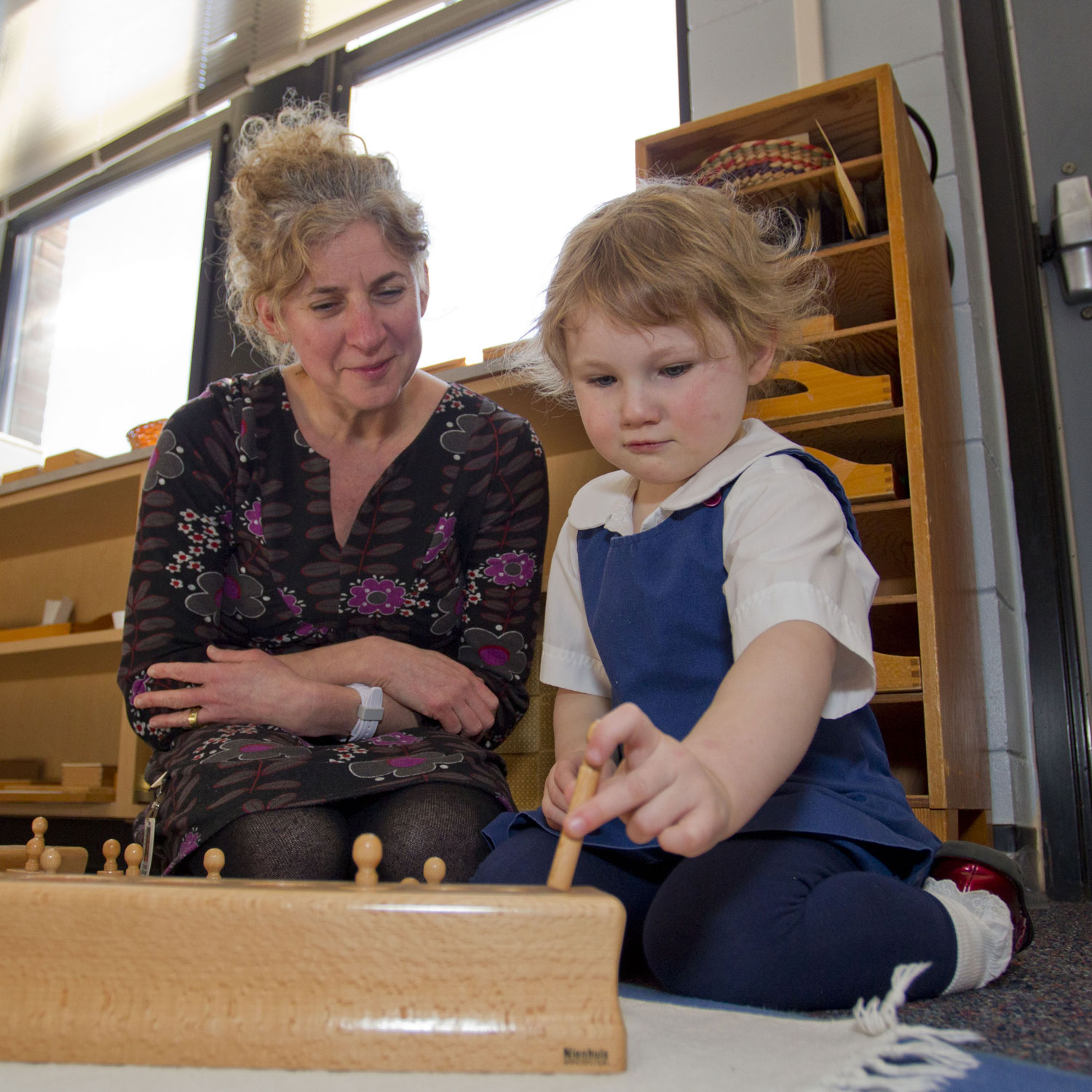 Montessori teacher and student
