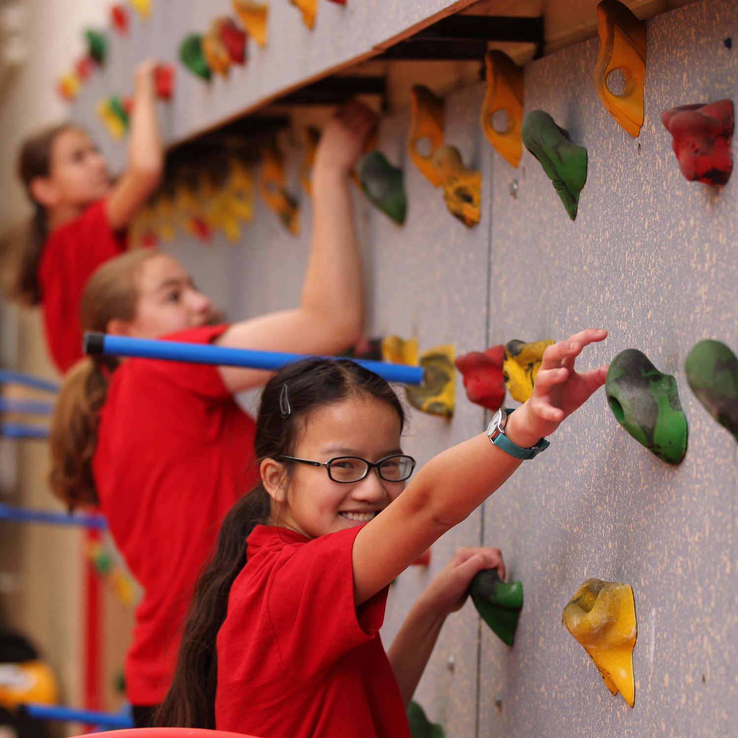 Middle School student on climbing wall